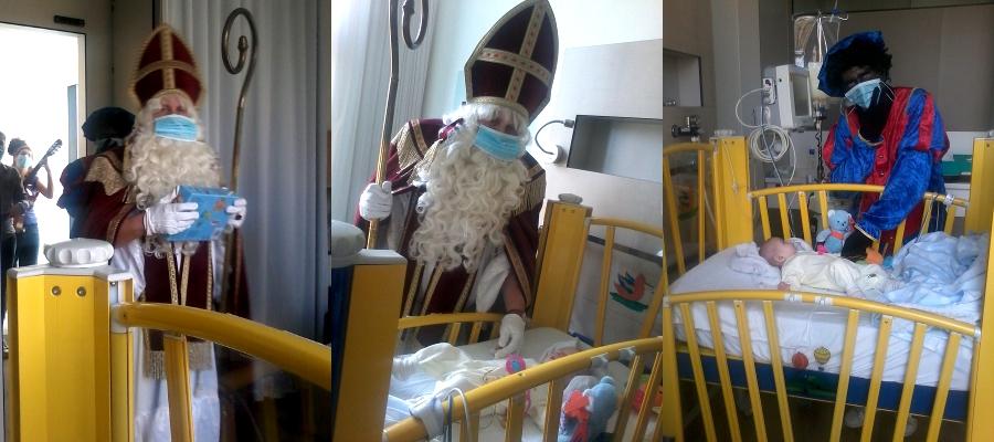 Święty Mikołaj oraz Czarny Piotruś odwiedzają dzieci w szpitalu UZA